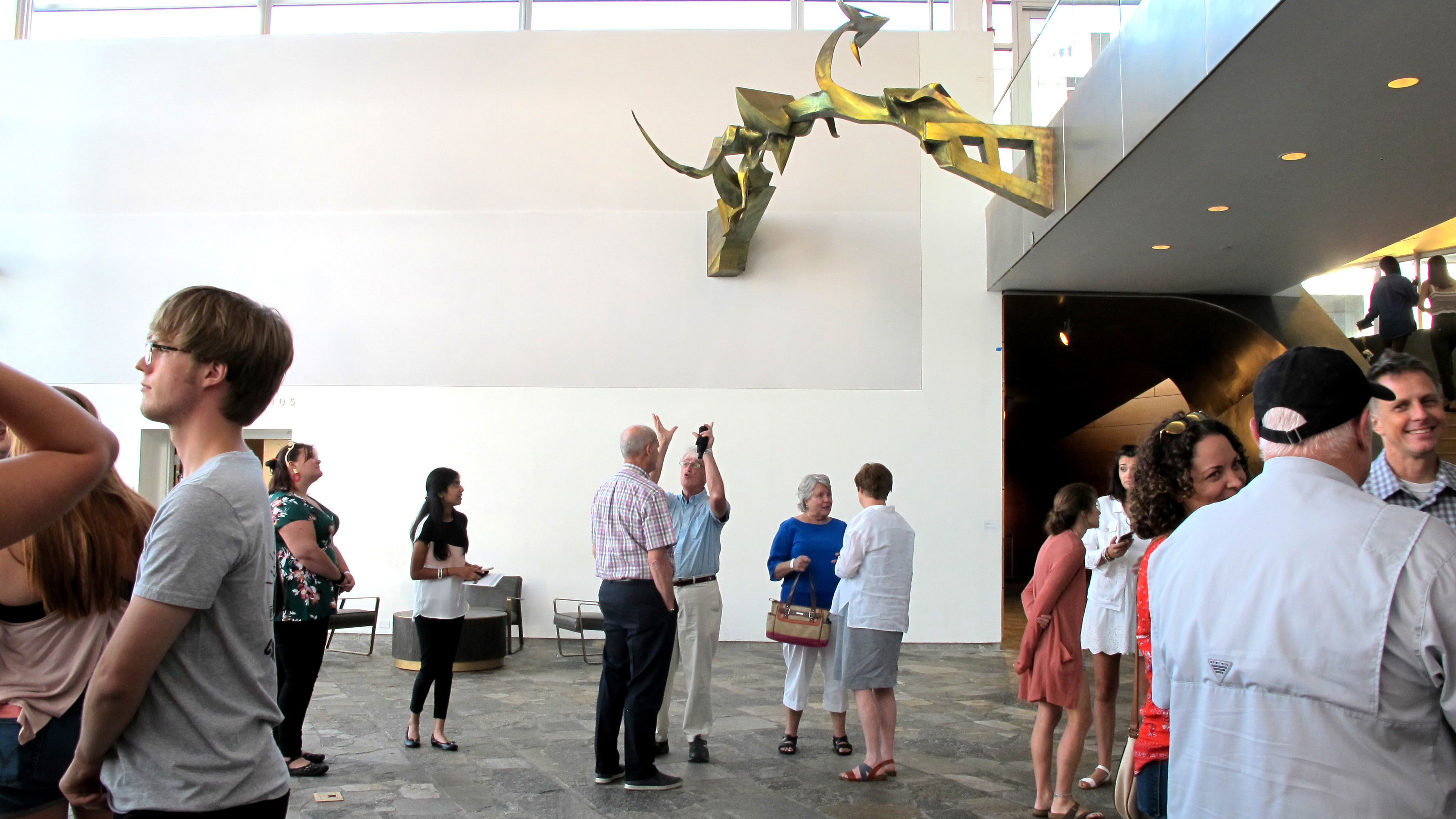 People mingle in the Hunter Museum lobby.