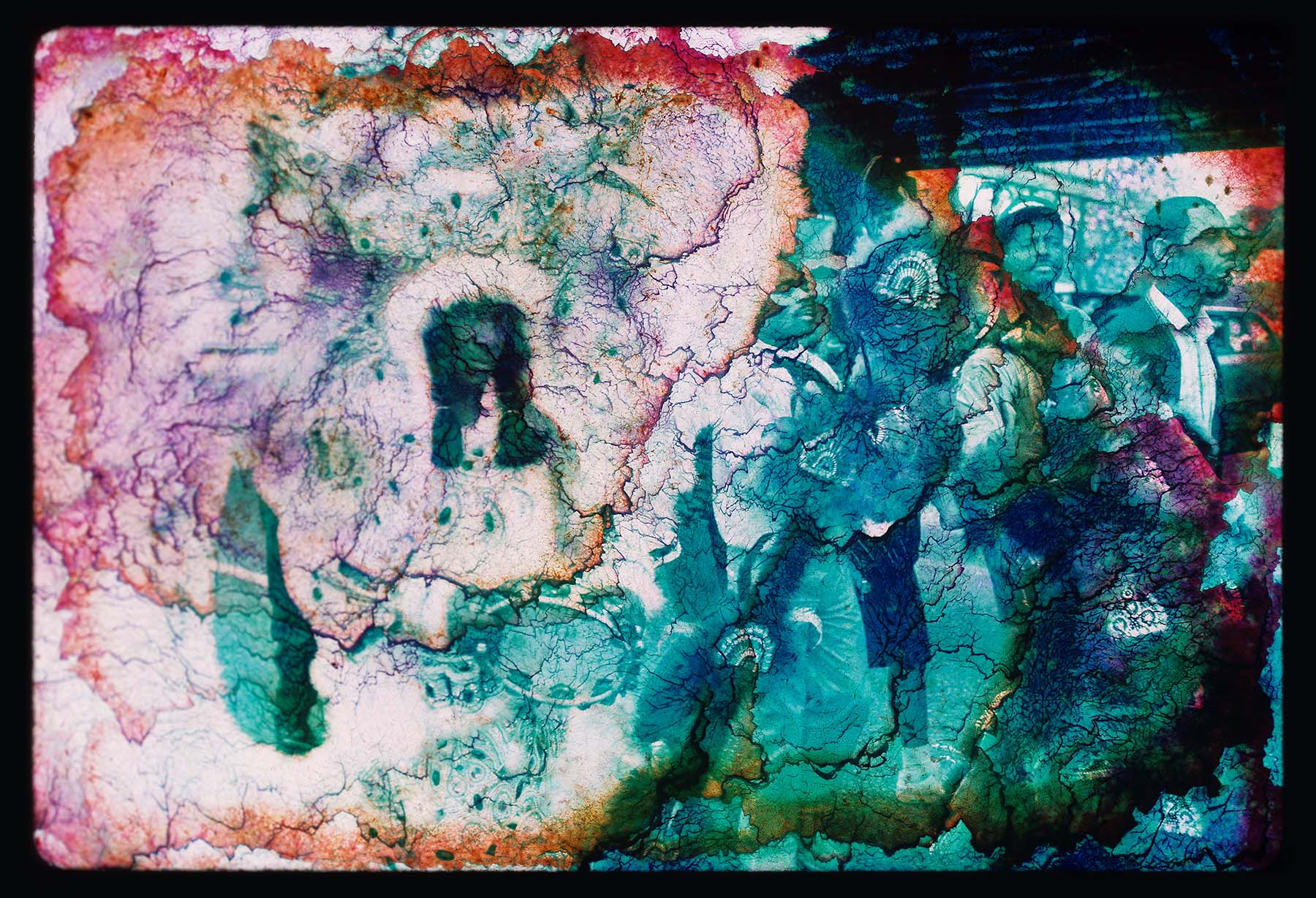 Image with water damage that has created an abstraction of the original photo of New Orleans people in costume.