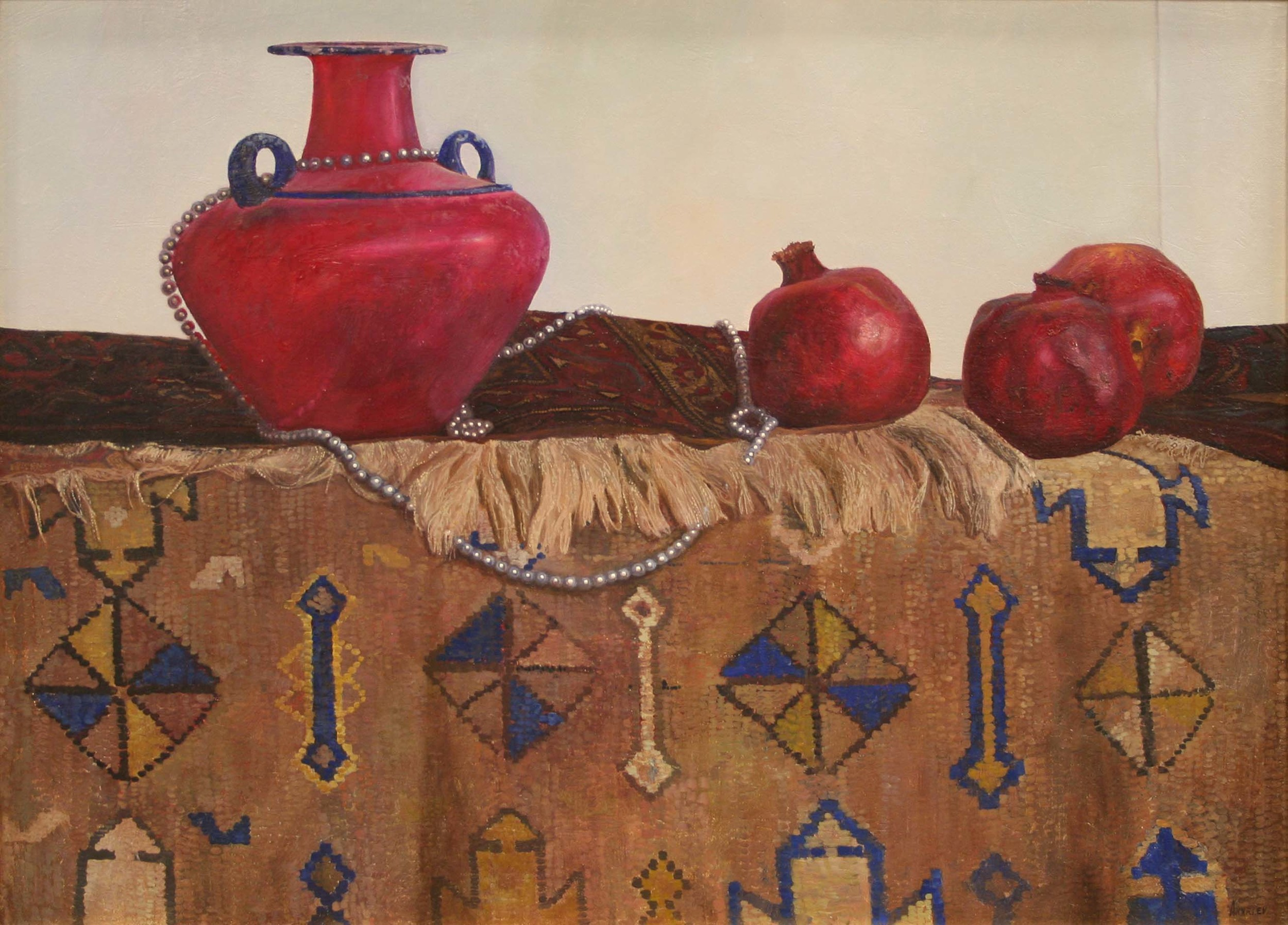 Two rugs with a red pot and pomegranates on it.