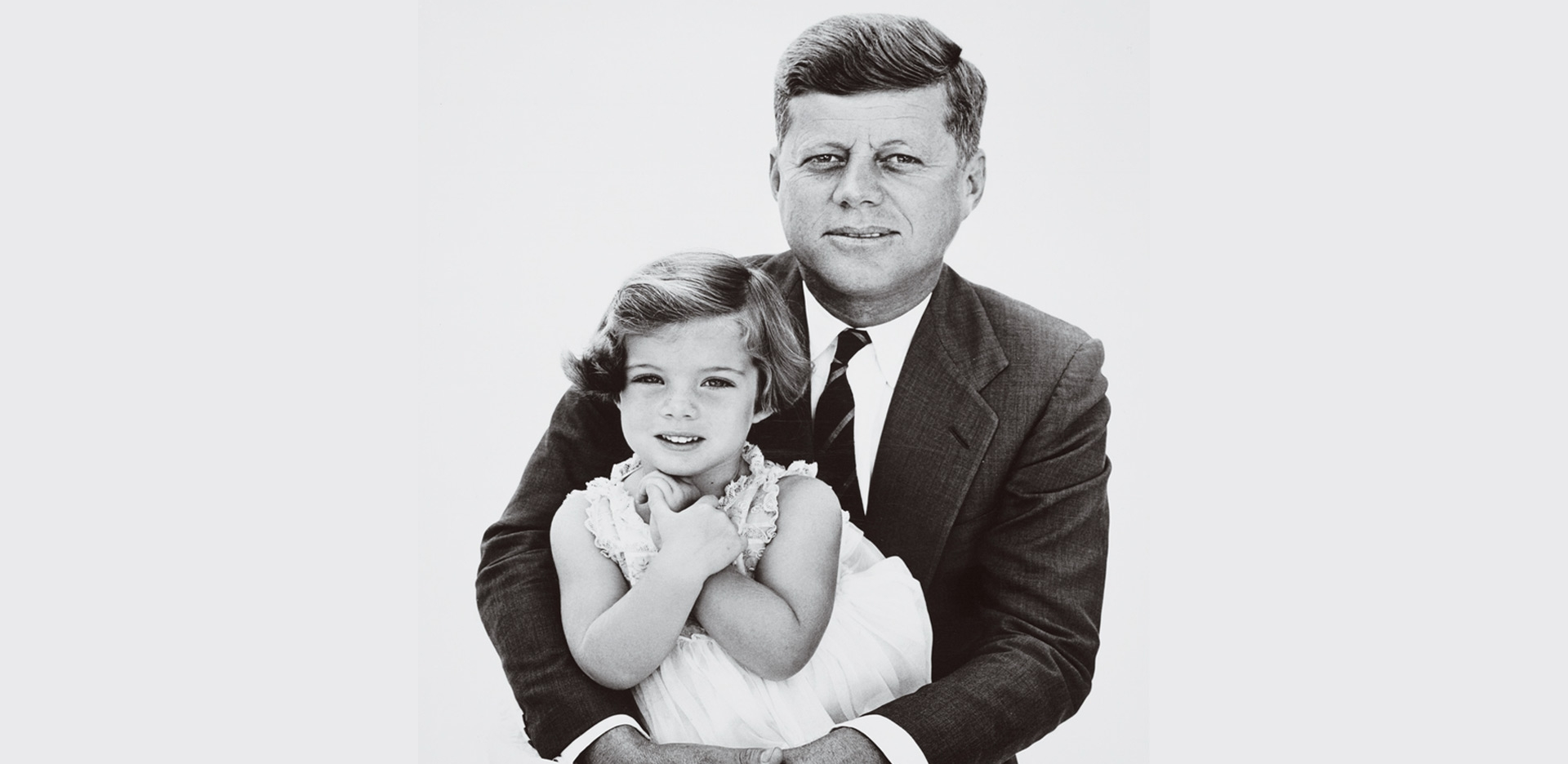 John F. Kennedy holding his daughter.
