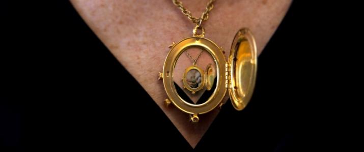 An open locket reveals a smaller open locket within it. The locket is being worn.