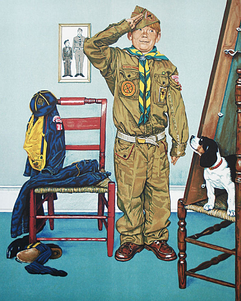 A young boy in an ill fitting uniform salutes. Behind him is an image of him with an older man in uniform. His clothes are piled on a chair next to him.