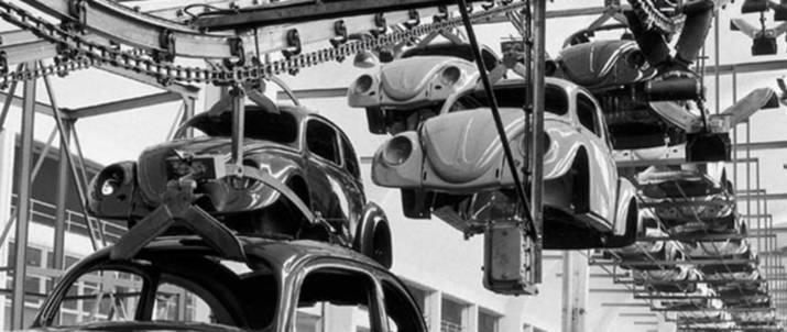 Volkswagen Beetles on an assembly line.