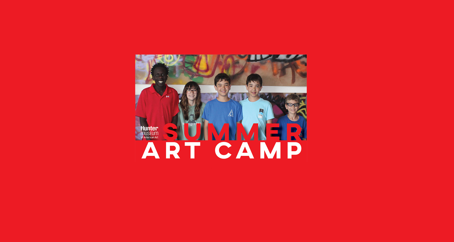 """A row of children posing for a picture in front of graffiti with the text, """"Summer Art Camp."""""""