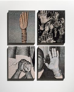 Four tapestries depicting hands of Black people.