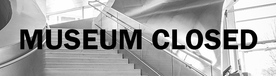 """Grey background of museum lobby with the text, """"Museum closed."""""""